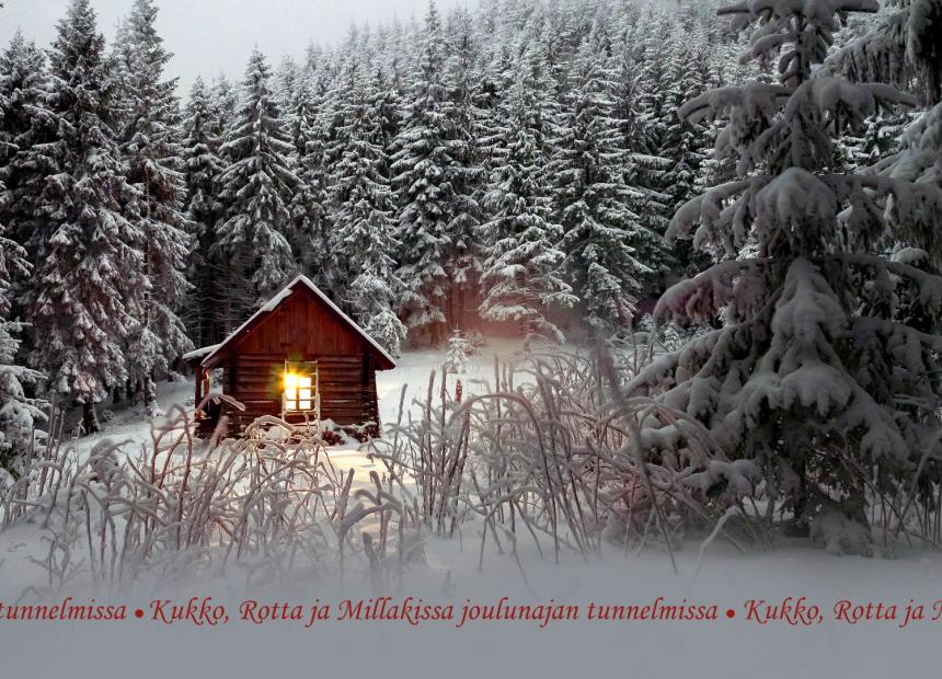 Lumisessa kuusikossa on pieni punainen mökki, jonka ikkunasta kajastaa lämmin valo.